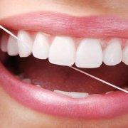 utilizzo filo interdentale studio dentistico motta rossi milano centro